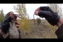 Охотник с вальдшнепом в руках