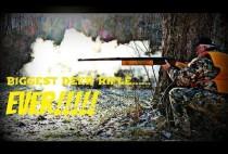 Охотник стреляет из ружья