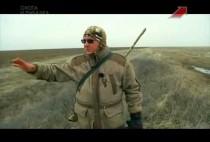 Охотник на гусей на поле