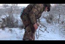 Охотник ставит капкан
